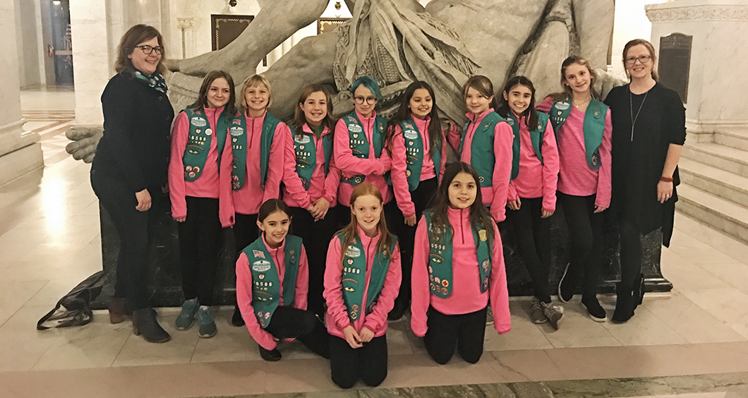 Local Girl Scout Troop 16566 pose for a picture at City Hall in Minneapolis