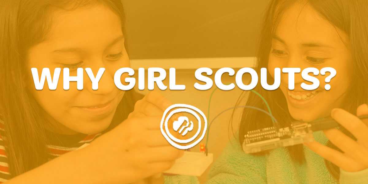 Two girl scouts connecting wires on a circuit board with text, Why Girl Scouts?