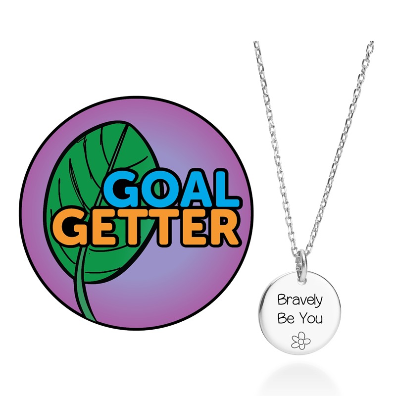A purple circle patch that reads Goal Getter with a green leaf next to it and a silver necklace with circular charm tha treads Bravely Be You.